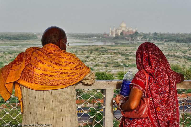 Indian couple overlooking Taj Mahal from the Agra Fort - Red Fort