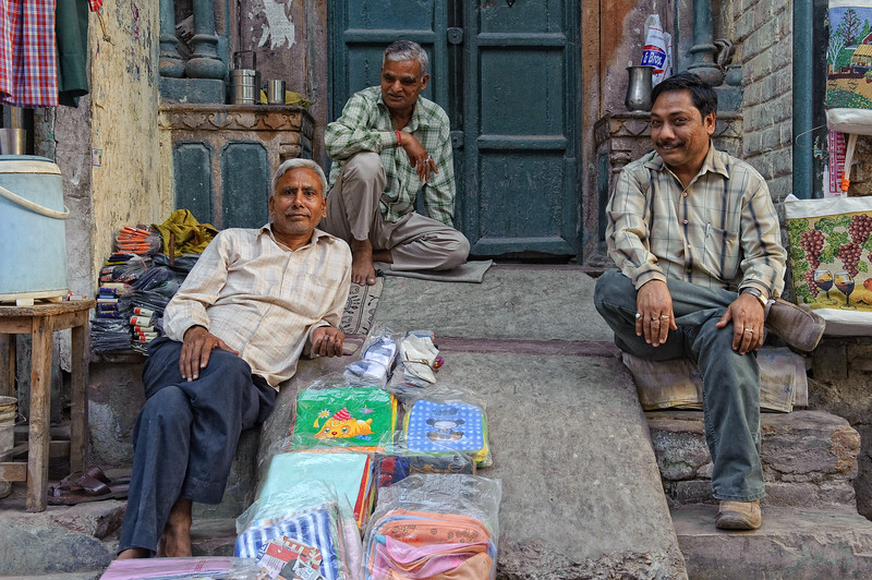 Trio trying to sell some texiles at Main Bazaar, Delhi