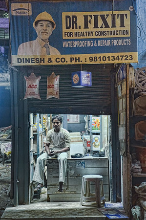 Mr Fix it waiting on a side road of Main Bazaar road, Delhi