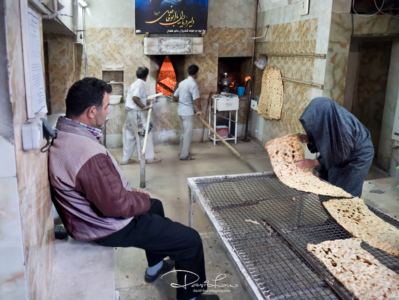 This is Sangak bread, one of the most common and popular bread in Iran . We ate a lot of this. Iranians will have bread for breakfast, lunch and dinner, besides the assorted basmati rice.  The bread is baked on a bed of hot pebbles lined at the peripheral in a traditional oven.   Sometimes the pebbles are dislodged from the oven and sticked onto the bread. The buyer will pick up the pebbles and throw it onto the floor. Notice the floor has many small pebbles!   At the end of the day, the baker will salvage the pebbles. Am not sure how they cement back lost pebbles back into the oven.