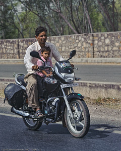 Son with his dad on a motorbike