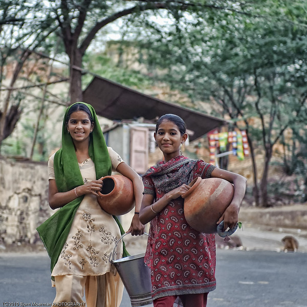 Girls getting drinking water in Galta