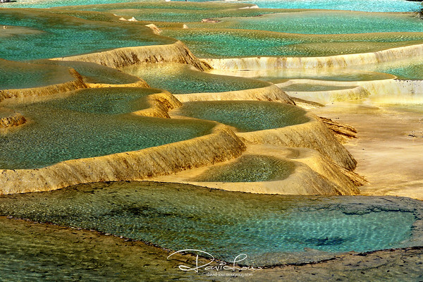 The name Multi-Coloured Pond is quite a misnomer. There wasn't like many different colours found in the pool. But the emerald and yellow deposits forming various patterns giving a shimmering golden hue is interesting enough.