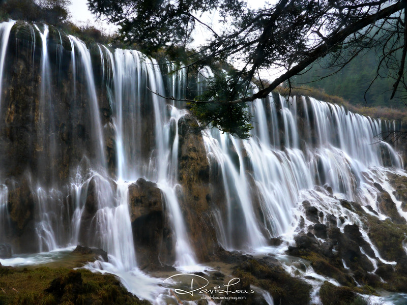 Norilang Waterfall (ranked one of the top six most beautiful waterfalls in China) - As the season change, the lakes take on a new appearance. At 320 metres in width and 25 metres in height, the spectacular Nuorilang Falls is the major travertine and widest waterfall in China.
