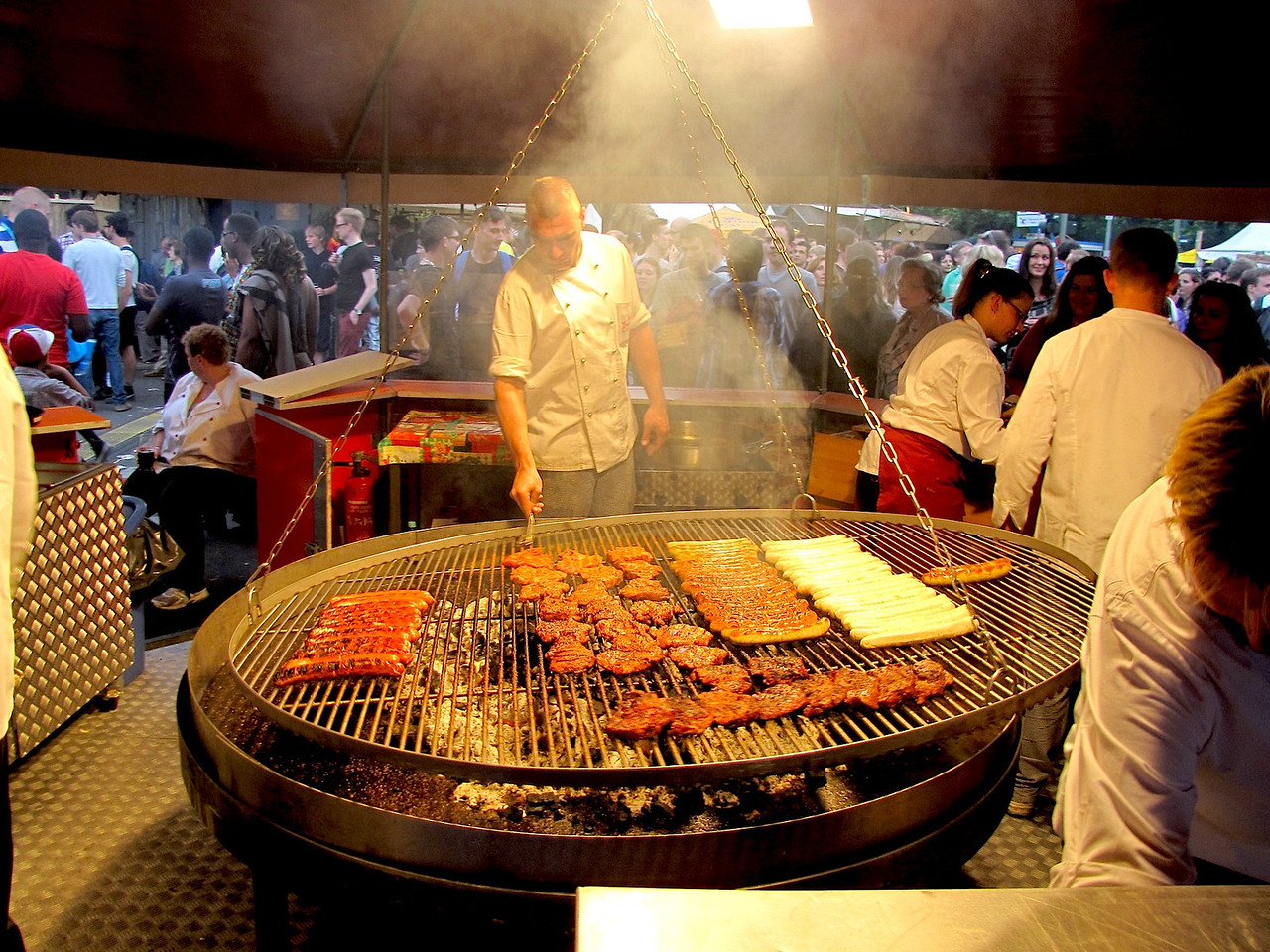 a swinging meat grill