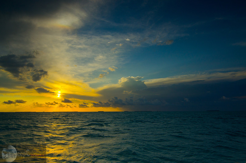 This shot was well awaited shot, I waited almost 3 hours for this one to happen. You can see the warmth of the sun in the left and coldness of the see in the right of the image. I love those different colors between the sun burst and the deep blue sky on the right. This was shot in the evening in Key West, bay of Maxico. Shot with Nikon D7000 and Nikkor 70-200mm VR at 200mm.