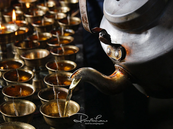 Korzok Monastery - filling cups with oil