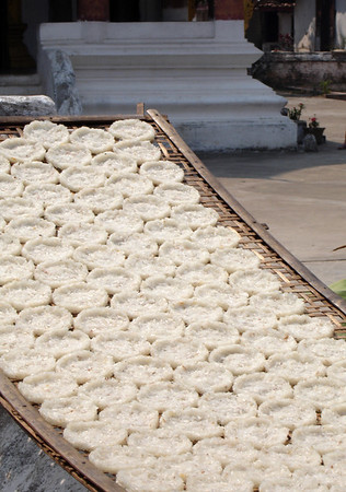 rice cakes drying in the sun at a local temple
