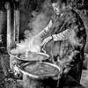 BHUTANESE MONK, COOKING DINNER