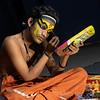 KATHAKALI DANCER APPLYING MAKEUP