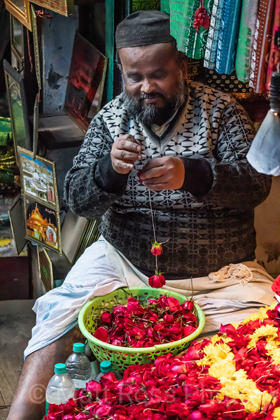 Muslim Man Preparing Rose Wreaths For Sale, Nizamudim Darga, (Sufi Masoleum)