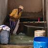 DHOBI KHANA, MAN WASHING CLOTHES