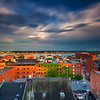 Looking over Wharf Street in Old Port Portland Maine to Casco Bay from Hyatt Place with Stormy Blue Sky and Golden Sunset Light
