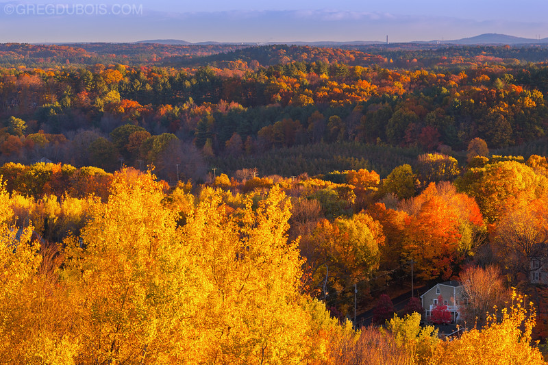 House with Rolling Hills of Fall Foliage and Maine Horizon at Sunrise from Amesbury Massachusetts