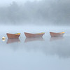 Moored Dory Boat Daisy Chain on Merrimack River under Heavy Fog with Sea Smoke, Lowell's Boat Shop Amesbury Massachusetts