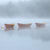 Moored Dory Boat Daisy Chain on Merrimack River under Heavy Fog with Sea Smoke, Lowell's Boat Shop Amesbury Massachusetts