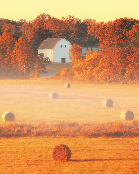 Golden Autumn Sunrise over Barn and Hay Bales in Salisbury Massachusetts