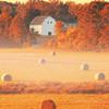 Golden Autumn Sunrise over Barn and Hay Bales in Salisbury Massachusetts