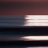 Winthrop Beach Dark Swells with Rising Sun Reflection and Pan Motion