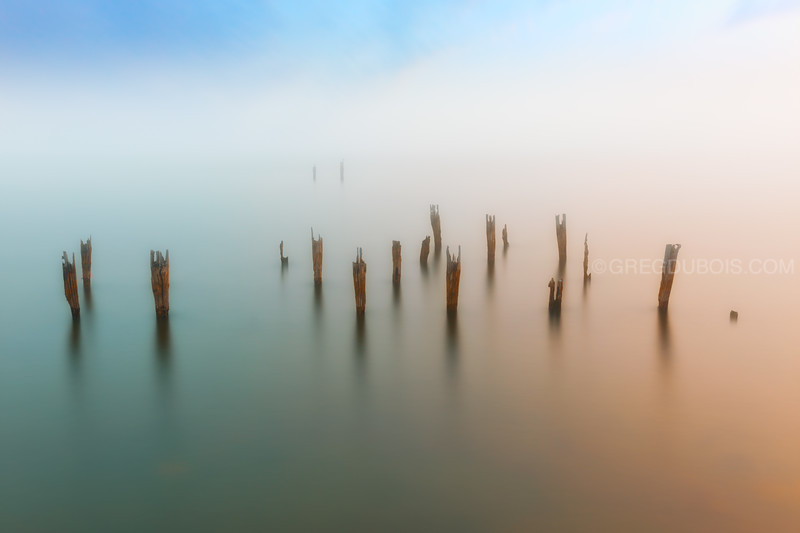 Fog Breaks over Decayed Pier in Boston Harbor at Sunset