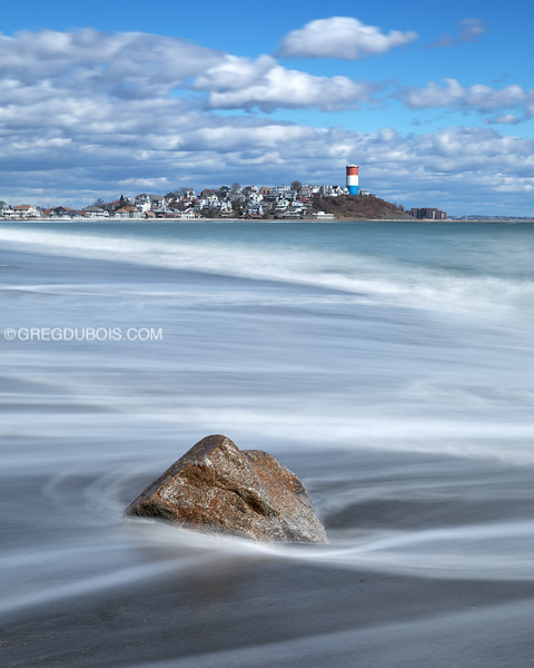 Yirrell Beach and Cottage Hill in Winthrop Massachusetts with Cloudy Blue Sky