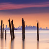 Boston Skyline through Decayed Pier and Sunset from Lovells Island