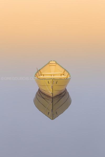 Solo Dory Boat at Sunrise on Foggy Merrimack River in Amesbury Massachusetts