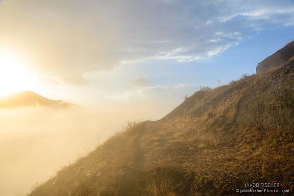 Morning sunburst over Alamat Castle, Iran
