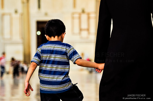 child with its mother in the Umayyad Mosque in Damascus, Syria