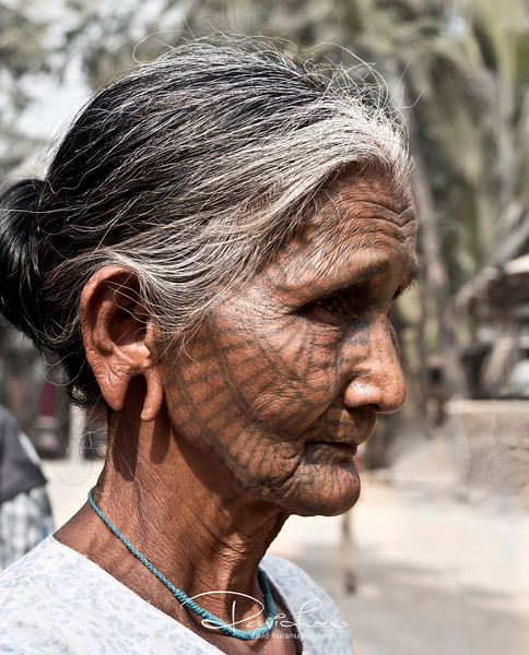 Chin tribe 4 - Her ear must have taken a toil wearing those big ring.