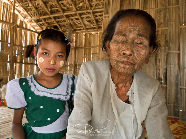 Chin tribe family. All tribes dwelled in attap houses built on  stilt.