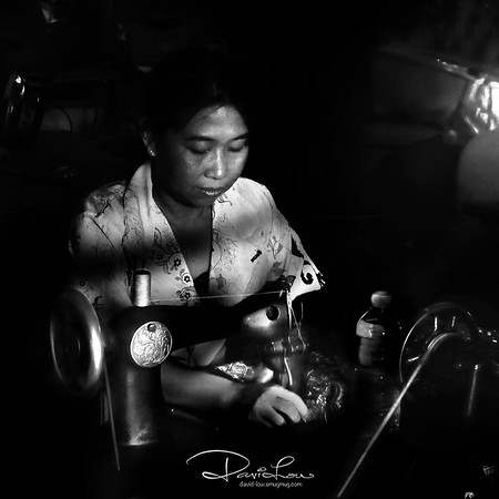 A seamstress working in an under daylight environment
