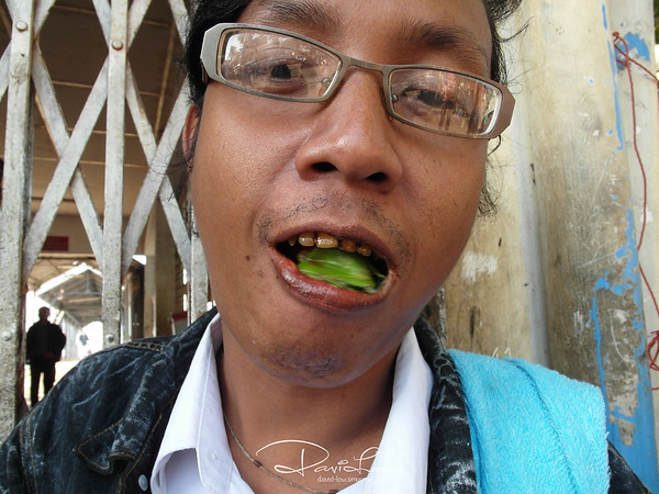 "Betel nut eater - This picture was the result of one fleeting opportunity during my street walking.  It pays to use a P&S camera where a stranger felt more comfortable even for a close up shot like this-about 6"" from his mouth.  (taken with EX-1)."