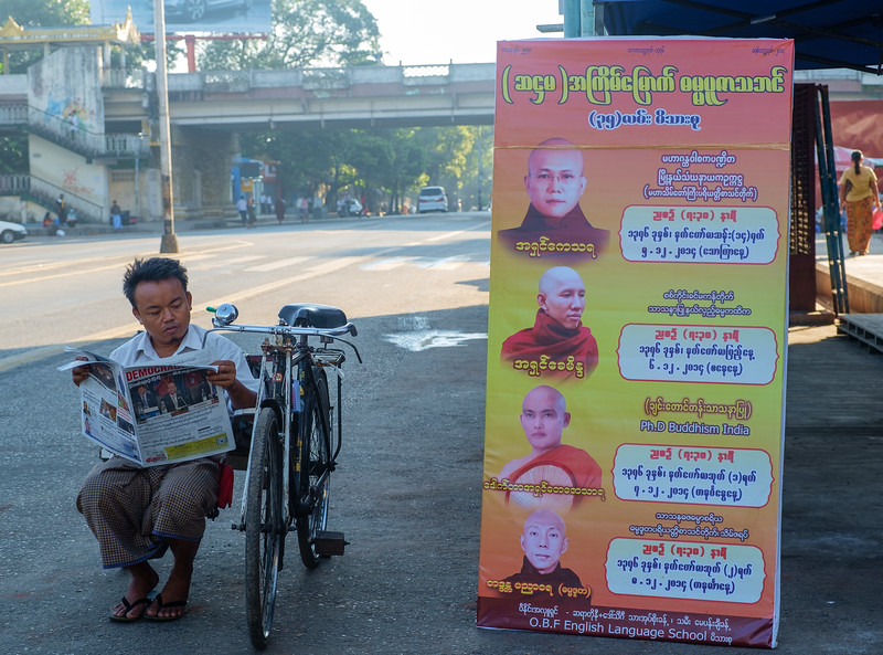 Reading the morning paper in Yangon
