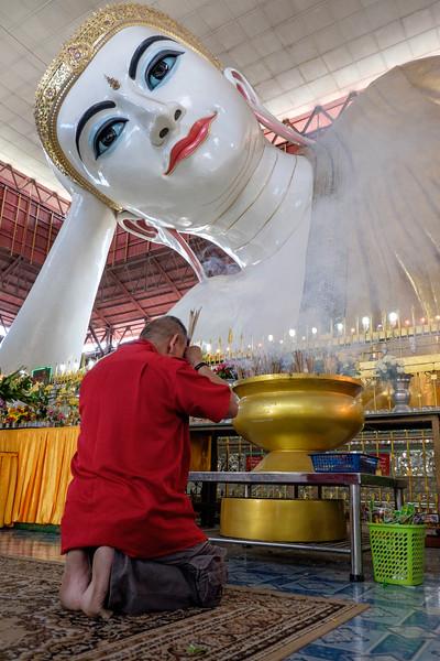 Praying at the Chaukhtetgyi Reclining Buddha, Yangon