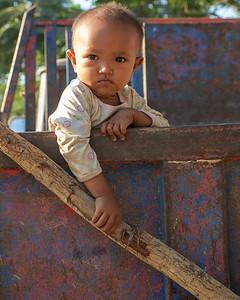 Baby in a truck at Ayeyarwadi river, Myanmar