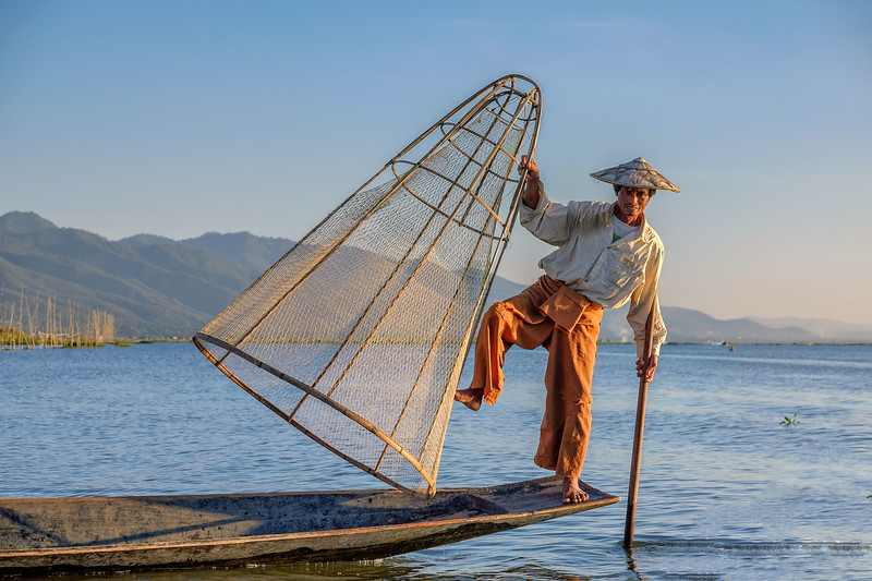 Balancing act by Inle lake fisherman