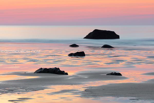 Hampton Beach New Hampshire at Sunrise with Low Tide Sea Rocks