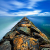 Hampton Beach Jetty under Blue Sky and Clouds with Turquoise Blue Atlantic Ocean, New Hampshire USA