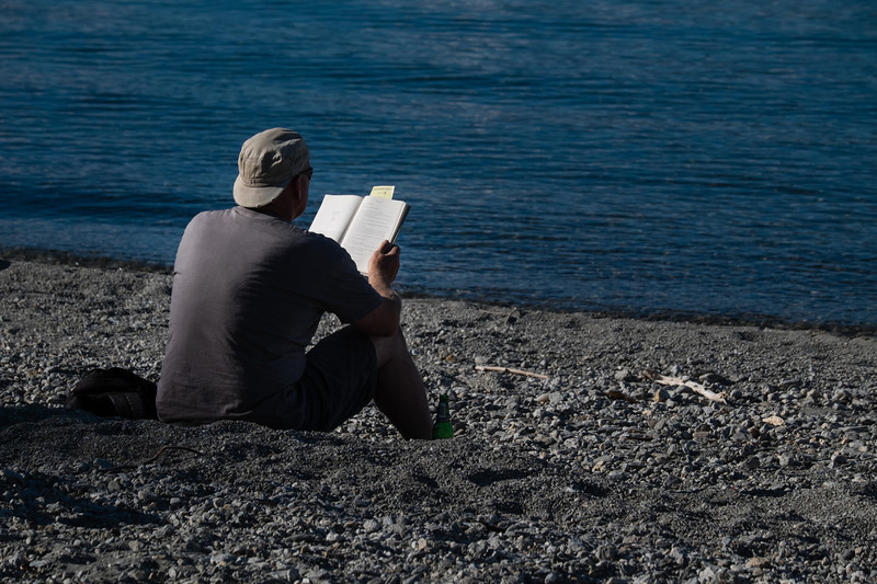 Reading a book at Lake Wanaka