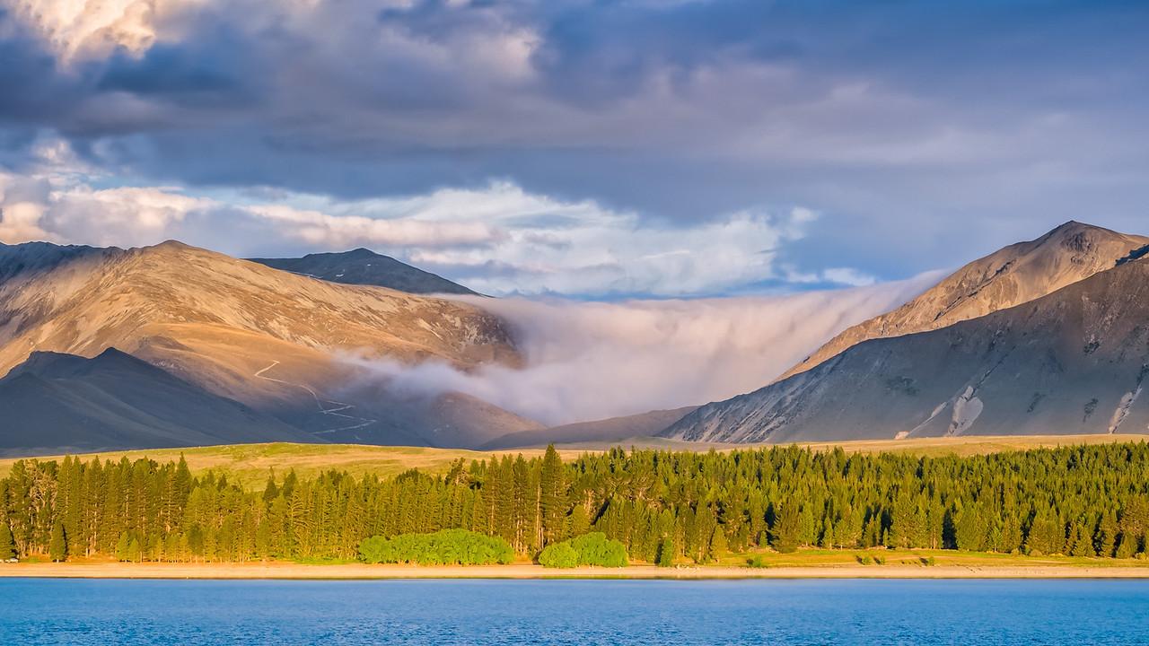 Clouds drifting into Lake Tekapo