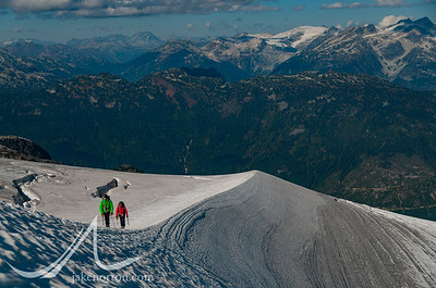 Climbers ascend a sway-backed arete on the Rainbow Glacier, British Columbia, Canada.