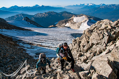 Seth Waterfall and Dave Hahn make their way up a rocky peak above the Rainbow Glacier, British Columbia, Canada.