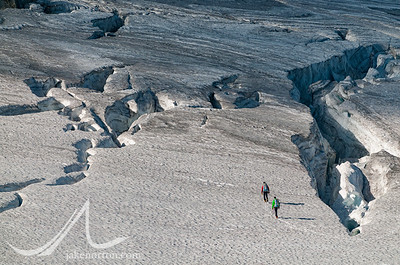 Climbers pick a route through crevasses on the Rainbow Glacier, British Columbia, Canada.