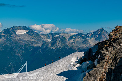 Climbers on a ridge above the Rainbow Glacier, British Columbia, Canada.