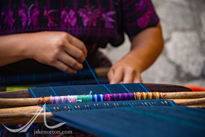 A Mayan woman weaves traditional textiles in rural Guatemala.