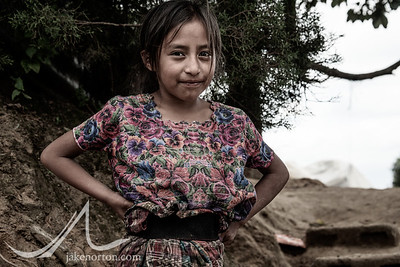 A young Mayan girl stands near her home in rural Guatemala.