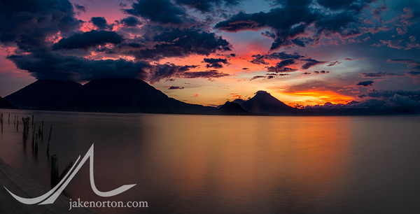 Panorama of Lake Atitlan, Guatemala, at sunset from Santa Catarina Polopo showing the volcanoes of Toliman and San Pedro.