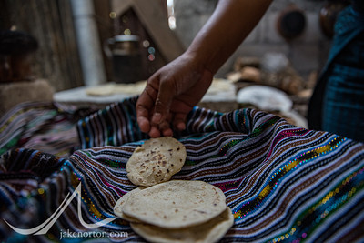 Fresh tortillas being laid out on a traditional Mayan cloth on Lake Atitlan, Guatemala.