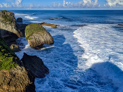 Surf and wild rock shapes on Survival Beach, Maleza Baja, Aguadilla, Puerto Rico.